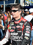 Sprint Cup Series driver Jeff Gordon (24) is waiting for the driver introductions before the Nascar Sprint Cup Series AAA Texas 500 race at Texas Motor Speedway in Fort Worth,Texas. Sprint Cup Series driver Jimmie Johnson (48) wins the AAA Texas 500 race.