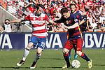 Granada's Isaac Cuenca (l) and FC Barcelona's Leo Messi during La Liga match. May 14,2016. (ALTERPHOTOS/Acero)