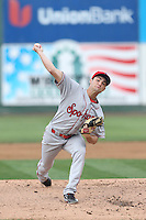 Nick Green (12) of the Spokane Indians pitches during a game against the Everett AquaSox at Everett Memorial Stadium on July 25, 2015 in Everett, Washington. Spokane defeated Everett, 10-1. (Larry Goren/Four Seam Images)