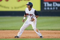Jose Castro #2 of the Carolina Mudcats takes his lead off of second base against the Jacksonville Suns at Five County Stadium May 15, 2010, in Zebulon, North Carolina.  Photo by Brian Westerholt /  Seam Images