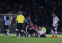 Jack Grimmer of Fulham receives treatment on the pitch before being stretchered off during the Capital One Cup match between Wycombe Wanderers and Fulham at Adams Park, High Wycombe, England on 11 August 2015. Photo by Andy Rowland.