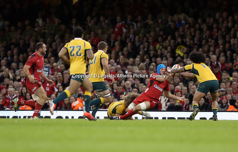 Pictured: Justin Tipuric of Wales (blue helmet) loses the ball to Joe Tomane of Australia (R) Saturday 08 November 2014<br /> Re: Dove Men Series rugby, Wales v Australia at the Millennium Stadium, Cardiff, south Wales, UK.