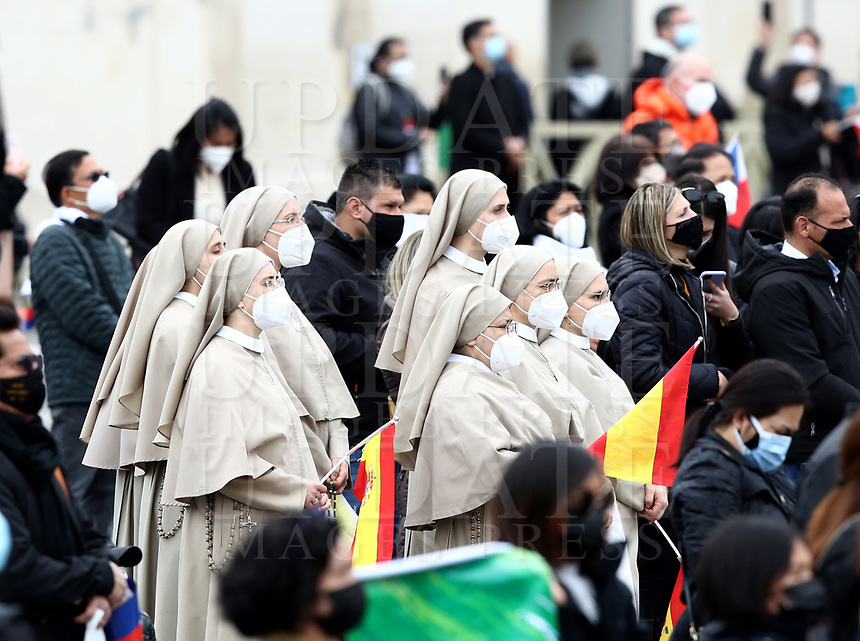Nuns wearing face masks to curb the spread of COVID-19, listen to Pope Francis Angelus noon prayer he recited from the window of his studio overlooking St.Peter's Square, at the Vatican, Sunday, March 14, 2021. <br /> UPDATE IMAGES PRESS/Isabella Bonotto<br /> <br /> STRICTLY ONLY FOR EDITORIAL USE