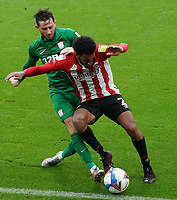 Brentford's Dominic Thompson is tackled by Preston North End's Alan Browne<br /> <br /> Photographer Stephanie Meek/CameraSport<br /> <br /> The EFL Sky Bet Championship - Brentford v Preston North End - Sunday 4th October 2020 - Griffin Park - Brentford<br /> <br /> World Copyright © 2020 CameraSport. All rights reserved. 43 Linden Ave. Countesthorpe. Leicester. England. LE8 5PG - Tel: +44 (0) 116 277 4147 - admin@camerasport.com - www.camerasport.com