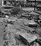Crews work to clear huge chunks of pavement and rock near Watertown's Main Street after flooding in September 1975.