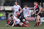 Dragons centre Jack Dixon tackles Ulster wing Mike Allen.<br /> Guinness Pro12<br /> Gwent Dragons v Ulster<br /> 08.03.15<br /> ©Steve Pope - SPORTINGWALES