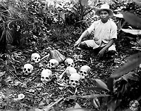 The Tapel Massacre on 1 July 1945.  Picture shows Pedro Cerono, the man who discovered the group of 8 skulls.  Tapel, Cagayan Province, Luzon, Philippine Islands.  November 23, 1945.  T5c. Lewis D. Klein.  (Army)<br /> NARA FILE #:  111-SC-227909<br /> WAR & CONFLICT BOOK #:  1250