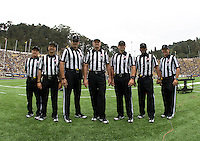 Game officialls, Terry Leyden, Frank Villar, Patrick Turner, Michael Feldman, Ryan Dickson, Steven Strimling, Steve Hudson, Jim Fogltance and Cleo Robinson pose together for group picture before the game against Nevada at Memorial Stadium in Berkeley, California on September 1st, 2012.  Nevada Wolf Pack defeated California, 31-24.