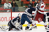 Nick Maricic (Yale - 31), Nick Jaskowiak (Yale - 5), Marshall Everson (Harvard - 21) - The Harvard University Crimson defeated the visiting Yale University Bulldogs 8-2 in the third game of their ECAC Quarterfinal matchup on Sunday, March 11, 2012, at Bright Hockey Center in Cambridge, Massachusetts.