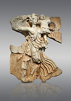 Roman Sebasteion relief  sculpture of the goddess Victory, Aphrodisias Museum, Aphrodisias, Turkey. <br /> <br /> A winged goddess Victory( Nike) flies past carrying a military trophy. She wears a long light dress and has one breast and one leg exposed. Her clothing is set in motion by her swift flight.