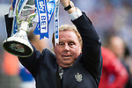 Queens Park Rangers 1 Derby County 0, 24/05/2014. Wembley Stadium, Championship Play Off Final. Harry Redknapp celebrates with trophy after the Championship Play-Off Final between Queens Park Rangers and Derby County from Wembley Stadium.  Photo by Simon Gill.