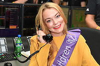 Lindsay Lohan<br /> on the trading floor for the BGC Charity Day 2016, Canary Wharf, London.<br /> <br /> <br /> ©Ash Knotek  D3152  12/09/2016