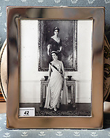 BNPS.co.uk (01202 558833)<br /> Pic: PhilYeomans/BNPS<br /> <br /> Princess Alexandra portrait.<br /> <br /> A remarkable 'timewarp' archive amassed by a dressmaker to the Queen has sold for over £100,000.<br /> <br /> The late Ian Thomas meticulously kept his fashion designs, letters, cards and photographs relating to the Queen at his home that was more like a museum. <br /> <br /> He helped design the Queen's coronation gown in 1953 as well as the powder blue outfit she wore for Charles and Diana's wedding in 1981.<br /> <br /> The lifelong bachelor passed away in 1993 and left his home and its contents to a florist he had been good friends with for 25 years.<br /> <br /> After she died in 2015 the property was inherited by a relative who also knew Mr Thomas well.<br /> <br /> She has now sold the contents at auction.