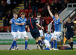St Johnstone v Hearts..19.12.15  SPFL  McDiarmid Park, Perth<br /> Juanma Delgado Lloria headbuts David Wotherspoon as Liam Craig appeals to ref Kevin Clancy<br /> Picture by Graeme Hart.<br /> Copyright Perthshire Picture Agency<br /> Tel: 01738 623350  Mobile: 07990 594431