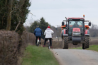 3-3-2021 Cyclists passing a tractor on the road  <br /> ©Tim Scrivener Photographer 07850 303986<br />      ....Covering Agriculture In The UK....