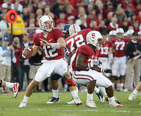 STANFORD, CA - November 6, 2010: Andrew Luck passes with protection from Stepfan Taylor during a 42-17 Stanford win over the University of Arizona, in Stanford, California.