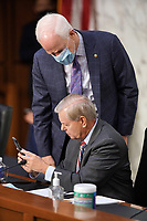 United States Senator Lindsey Graham (Republican of South  Carolina), Chairman, US Senate Judiciary Committee looks at the phone of United States Senator John Cornyn (Republican of Texas) during a business meeting prior to the fourth day for the confirmation hearing of President Donald Trump's Supreme Court nominee Judge Amy Coney Barrett on Thursday, October 15, 2020.<br /> Credit: Greg Nash / Pool via CNP /MediaPunch