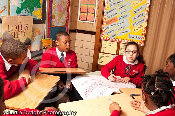 K-8 Parochial School Bronx New York Grade 5 social studies students working in small groups    horizontal