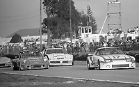 #17 Mazda RX-7 of Al Bacon, Charlie Guest and Bobby Akin Jr., # 56 Porsche 911 of Gary Auberlen, Pete Jauker and Adrian Gang and the # 90 Pontiac Firebird of Les Delano, Andy Petery and Patty Moise do battle in the 12 Hours of Sebring, at Sebring Raceway, Sebring, FL, March 23, 1985.  (Photo by Brian Cleary/www.bcpix.com)
