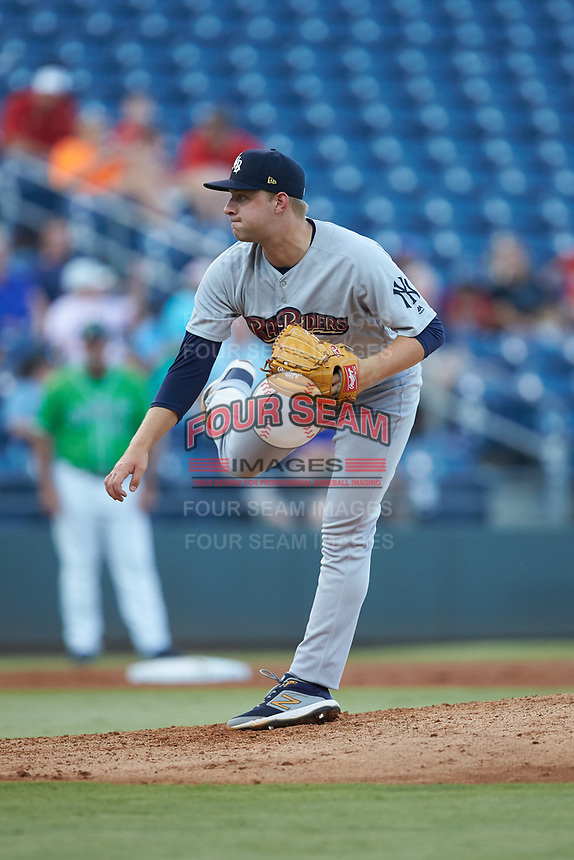 Scranton/Wilkes-Barre RailRiders starting pitcher Michael King (26) follows through on his delivery against the Gwinnett Stripers at Coolray Field on August 16, 2019 in Lawrenceville, Georgia. The Stripers defeated the RailRiders 5-2. (Brian Westerholt/Four Seam Images)