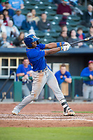 Midland RockHounds outfielder Dairon Blanco (15) connects on a pitch on May 4, 2019, at Arvest Ballpark in Springdale, Arkansas. (Jason Ivester/Four Seam Images)