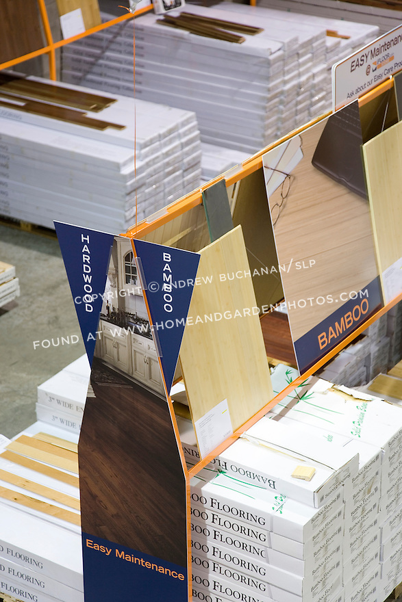 Packages of pre-manufactured bamboo flooring on display for sale at a warehouse-type store.