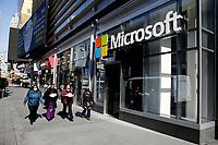 NEW YORK, NEW YORK - MARCH 10: People walk around a Microsoft store at Times Square on March 10, 2021, in New York. The Nasdaq Composite continued falling more than half a percent during the day also the move away from Apple Inc, Amazon.com Inc , Facebook Inc, Tesla Inc and Microsoft Corp, falling during the day, helped small-cap stocks rise more than double the gains of the S&P 500. (Photo by John Smith/VIEWpress)