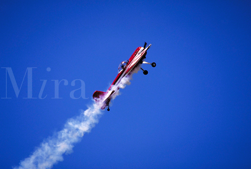 Ken Wieland in Yak 55 climbs at 50 degree angle inverted; near profile right; smoke trails. Ken Wieland. Watsonville California.