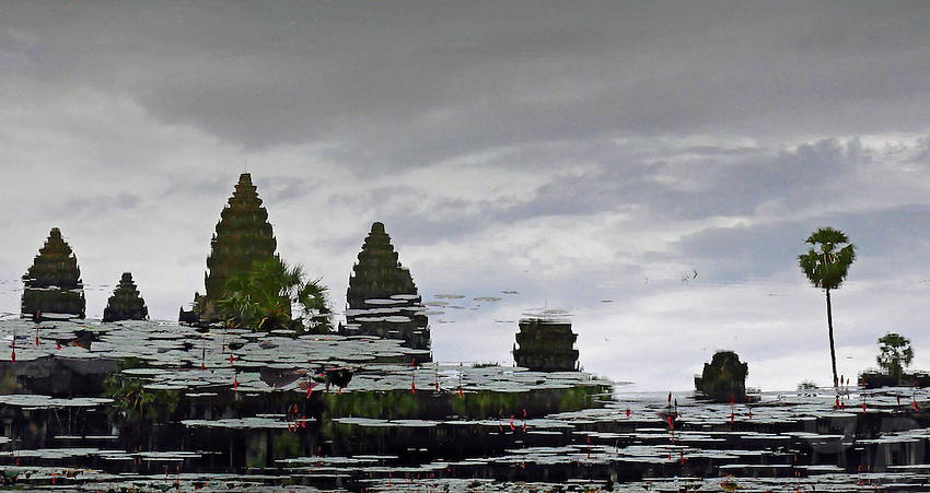 Reflection of the Khmer Bayon temple near Siem Reap, Cambodia