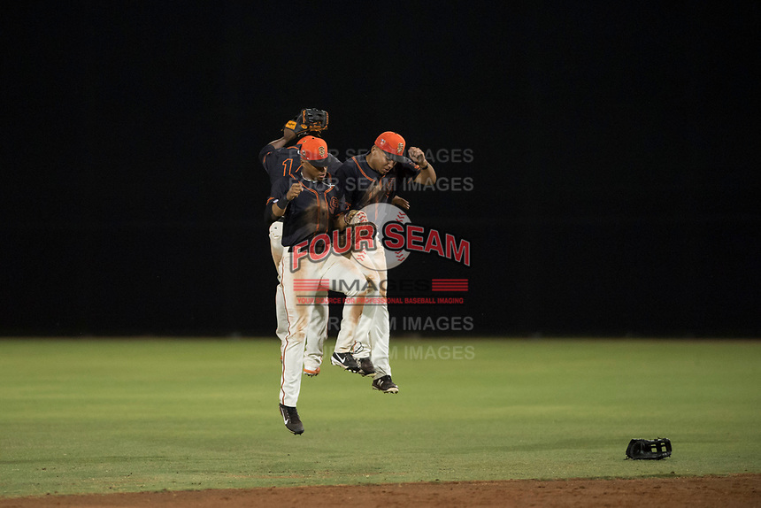 AZL Giants Black outfielders Randy Norris (1), Alexander Canario (14), and Franklin Labour (49) celebrate a victory after an Arizona League game against the AZL Angels at the San Francisco Giants Training Complex on July 1, 2018 in Scottsdale, Arizona. The AZL Giants Black defeated the AZL Angels by a score of 4-2. (Zachary Lucy/Four Seam Images)