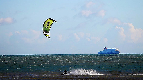Out on his own - the lone kite-surfer in Dublin Bay is at much less risk of COVID infection than the passengers on the cross-channel ferry