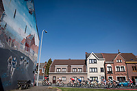 Riders passing the famous commemorative mural on the 1963 & 1988 World Championships finish line straight<br /> <br /> 76th Dwars door Vlaanderen 2021 (MEN1.UWT)<br /> 1 day race from Roeselare to Waregem (184km)<br /> <br /> ©kramon