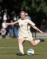 Boston College midfielder Lauren Bernard (5) passes the ball. .After two overtime periods, Boston College (gold) tied University of Miami (orange), 0-0, at Newton Campus Field, October 21, 2012.