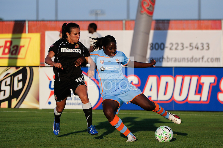 Anita Asante (5) of Sky Blue FC clears a ball away from Marta (10) of the Western New York Flash. The Western New York Flash defeated Sky Blue FC 4-1 during a Women's Professional Soccer (WPS) match at Yurcak Field in Piscataway, NJ, on July 30, 2011.