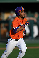 Second baseman Jordan Greene (9) of the Clemson Tigers runs out a batted ball in a game against the William and Mary Tribe on February 16, 2018, at Doug Kingsmore Stadium in Clemson, South Carolina. Clemson won, 5-4 in 10 innings. (Tom Priddy/Four Seam Images)