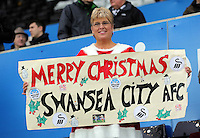 A Swansea supporter in a Santa outfit during the Premier League match between Swansea City and Sunderland at The Liberty Stadium, Swansea, Wales, UK. Saturday 10 December 2016