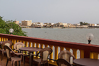 Senegal, Saint Louis.  Looking across the Senegal River toward the Langue de Barbarie Peninsula from La Saigonnaise Vietnamese Restaurant.