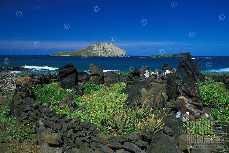 Modern Heiau (Hawaiian temple) built at Makapuu point with rabbit island in rear, Oahu