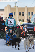 Jessica Klejka and team leave the ceremonial start line with an Iditarider at 4th Avenue and D street in downtown Anchorage, Alaska on Saturday March 2nd during the 2019 Iditarod race. Photo by Brendan Smith/SchultzPhoto.com