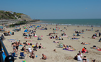 FOLKESTONE, KENT, England - 30.05.2020<br /> .<br /> People enjoy the summer weekend sun by relaxing at Folkestone Harbour, as the government lockdown is due to be relaxed further on Monday including allowing groups of 6 to meet up as the COVID-19 pandemic continues in High Wycombe, Bucks on 30 May 2020. Photo by Alan Stanford.