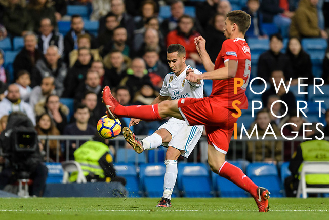 Lucas Vazquez of Real Madrid (L) fights for the ball with Simon Kjaer of Sevilla FC (R) during La Liga 2017-18 match between Real Madrid and Sevilla FC at Santiago Bernabeu Stadium on 09 December 2017 in Madrid, Spain. Photo by Diego Souto / Power Sport Images