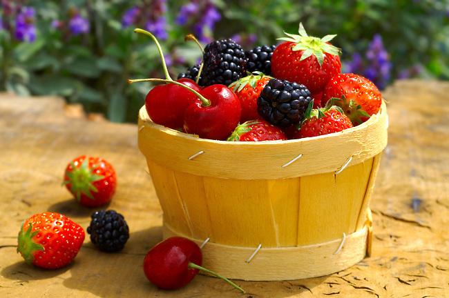 Mixed summer fruits - strawberries, cherries , blackberries