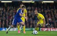 Oscar of Chelsea heads past Gal Alberman of Maccabi Tel Aviv during the UEFA Champions League match between Chelsea and Maccabi Tel Aviv at Stamford Bridge, London, England on 16 September 2015. Photo by Andy Rowland.