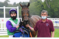 Winner of The Fovant Fillies' Handicap  Clever Candy (purple cap) ridden by Kieran Shoemark and trained by Michael Bell  in the Winners enclosure during Horse Racing at Salisbury Racecourse on 13th August 2020