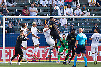 CARSON, CA - MAY 8: Jesus David Murillo #94 of LAFC  leaps high for a head ball during a game between Los Angeles FC and Los Angeles Galaxy at Dignity Health Sports Park on May 8, 2021 in Carson, California.
