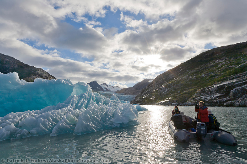 Tourists view icebergs in Nellie Juan Lagoon, Prince William Sound, southcentral, Alaska.
