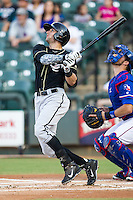 Omaha Storm Chasers designated hitter Paulo Orlando (16) follows through on his swing during the Pacific Coast League baseball game against the Round Rock Express on June 1, 2014 at the Dell Diamond in Round Rock, Texas. The Express defeated the Storm Chasers 11-4. (Andrew Woolley/Four Seam Images)