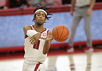 Arkansas guard Jalen Tate (11) passes the ball, Saturday, January 9, 2021 during the first half of a basketball game at Bud Walton Arena in Fayetteville. Check out nwaonline.com/210110Daily/ for today's photo gallery. <br /> (NWA Democrat-Gazette/Charlie Kaijo)