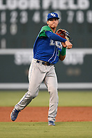 Shortstop Jeison Guzman (11) of the Lexington Legends throws out a runner during a game against the Greenville Drive on Saturday, September 1, 2018, at Fluor Field at the West End in Greenville, South Carolina. Greenville won, 9-6. (Tom Priddy/Four Seam Images)