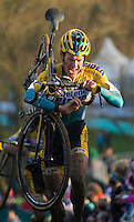 29 NOV 2014 - MILTON KEYNES, GBR - Tom Meeusen (BEL) from Belgium and Telenet–Fidea prepares to drop his bike to the ground after carrying it up a climb during the men's 2014-2015 UCI Cyclo-Cross World Cup round at Campbell Park in Milton Keynes, Great Britain (PHOTO COPYRIGHT © 2014 NIGEL FARROW, ALL RIGHTS RESERVED)